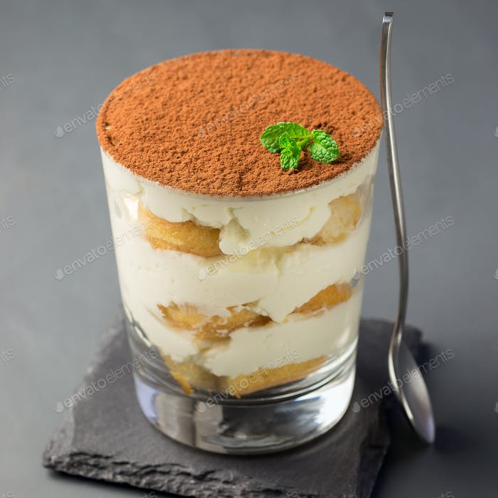 Traditional italian Tiramisu dessert cake in a glass, decorated