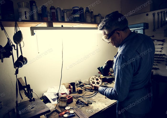 A man is working in a workshop