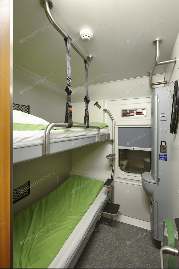 Train berth indoor with two beds. Travel background. Vertical