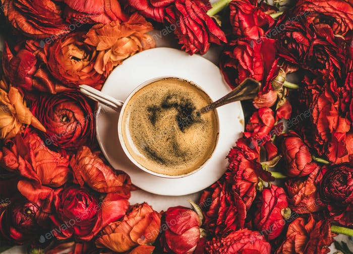 Black espresso coffee in white cup on red flower background