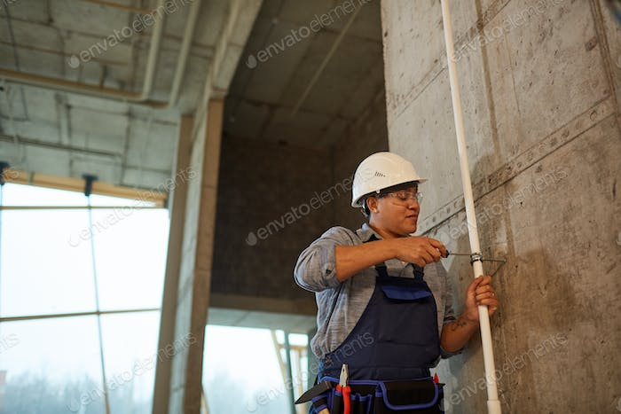 Mixed-Race Female Plumber Working