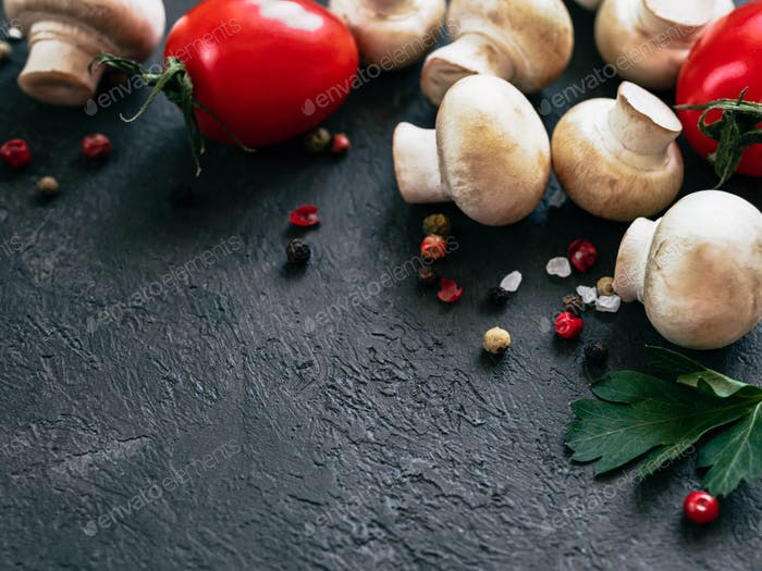 Food ingredients on black background, copy space