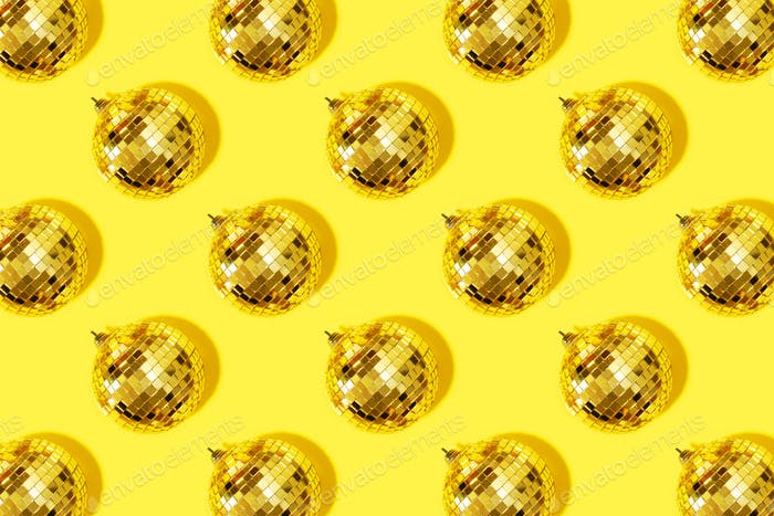 Thumbnail for Creative Christmas pattern. Shiny gold disco balls over yellow background. Flat lay, top view. New