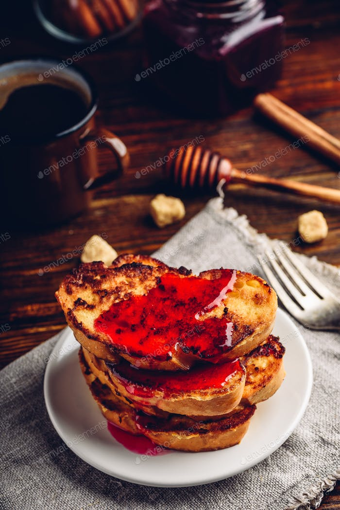 Stack of french toasts with berry marmalade