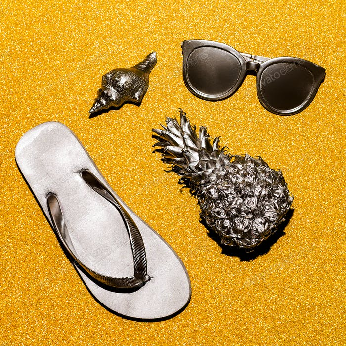 Silver beach set on a gold background. Vacation outfit