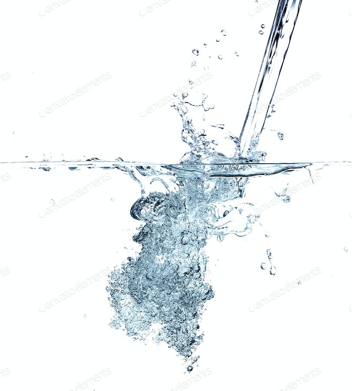 Water making bubbles upon being poured into more water.