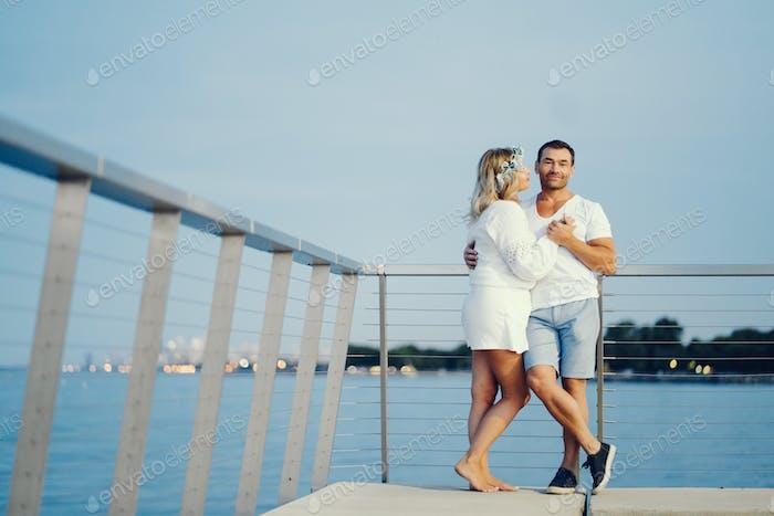 elegant adult couple near sea