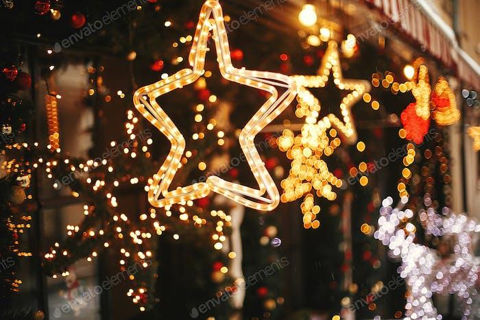 Stylish christmas golden star illumination and fir branches