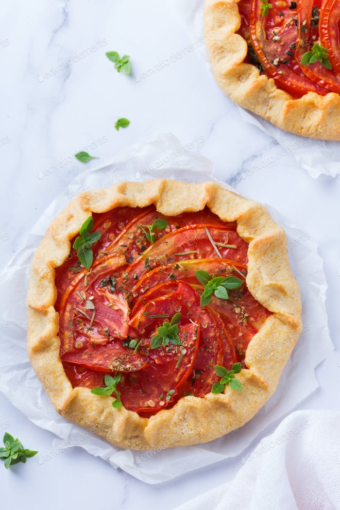 Homemade seasonal savoury summer tomato galette, tart, pie