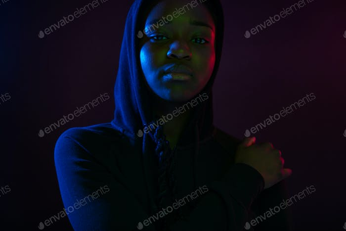 Colorful portrait of a cool woman with dark skin wearing hoodie