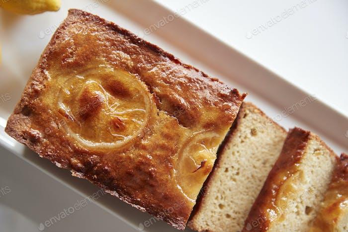 Freshly Baked Lemon Slice Cake On Stand In Coffee Shop