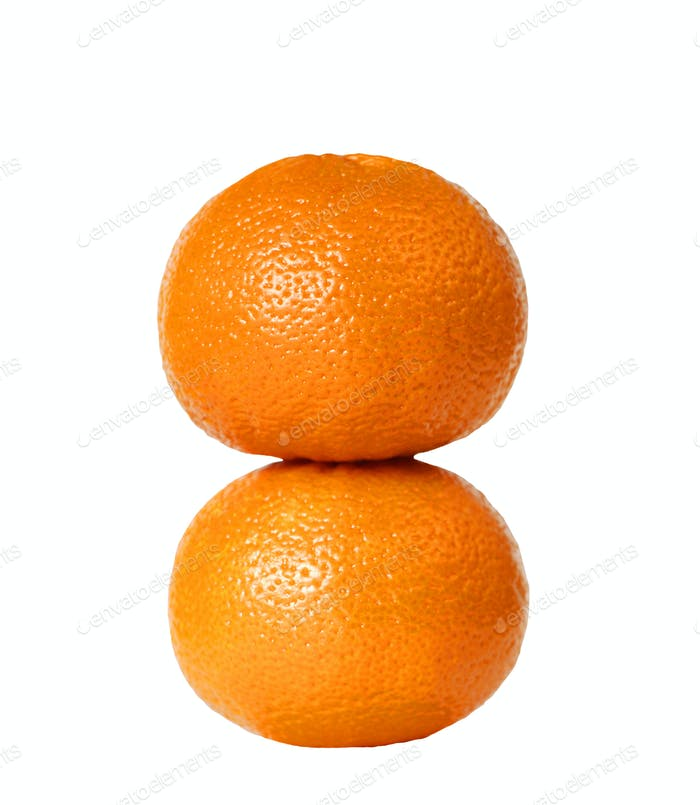 Two oranges stacked together isolated