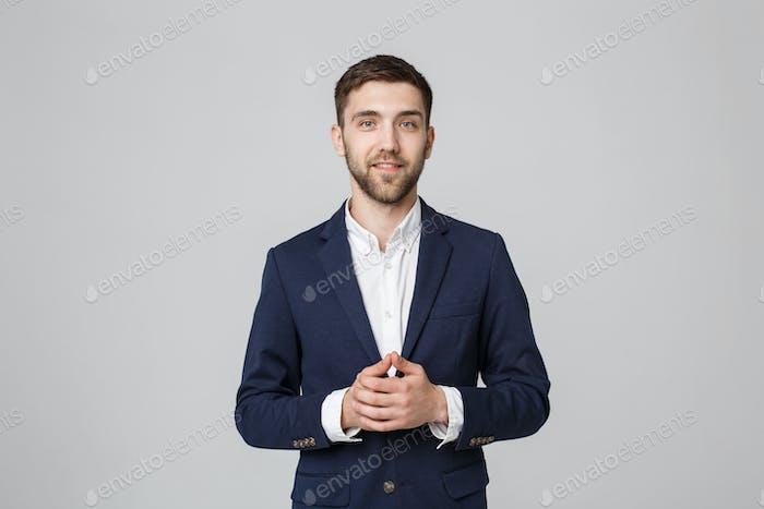 Placeit - Portrait Handsome Businessman holding hands with confident face.