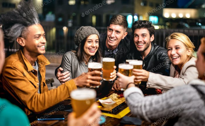 Happy friends group drinking beer at brewery bar outdoors