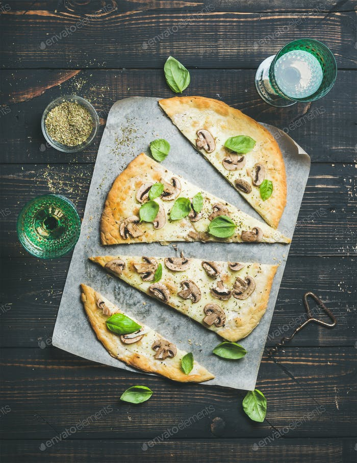 Homemade mushroom pizza with basil and rose wine