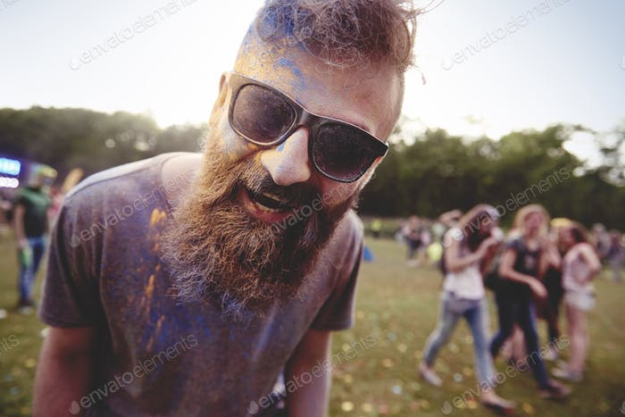 Portrait of man in holi colors
