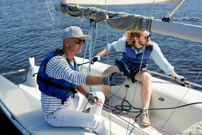 Father and son in sailboat