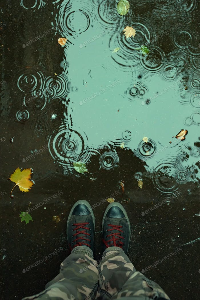 Thumbnail for Standing in the drizzle puddle on the street