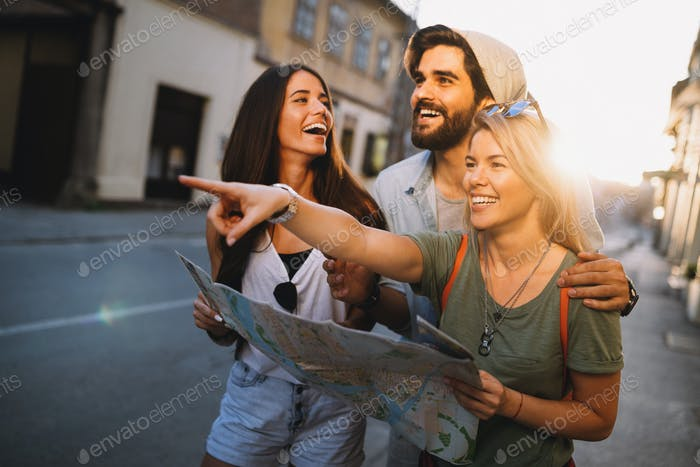 Happy friends enjoying sightseeing tour in the city