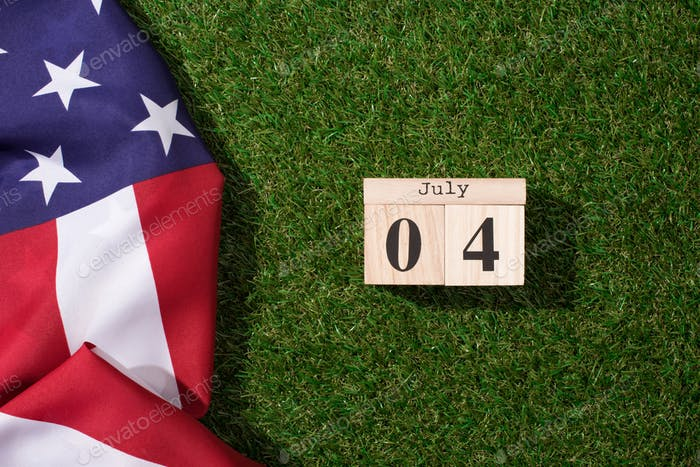 American Flag And Wooden Calendar With 4th July Date