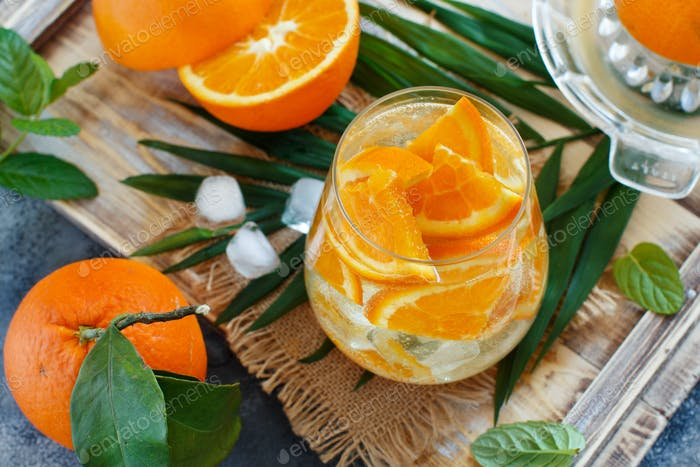 Homemade refreshing drink with soda and orange juice