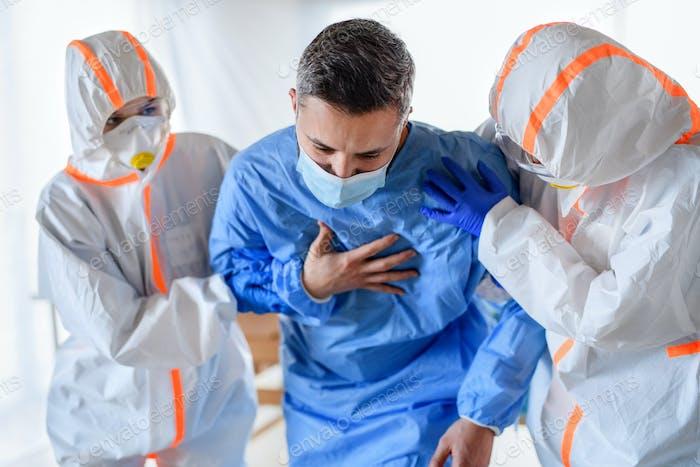Doctors with infected patient in quarantine in hospital, coronavirus concept