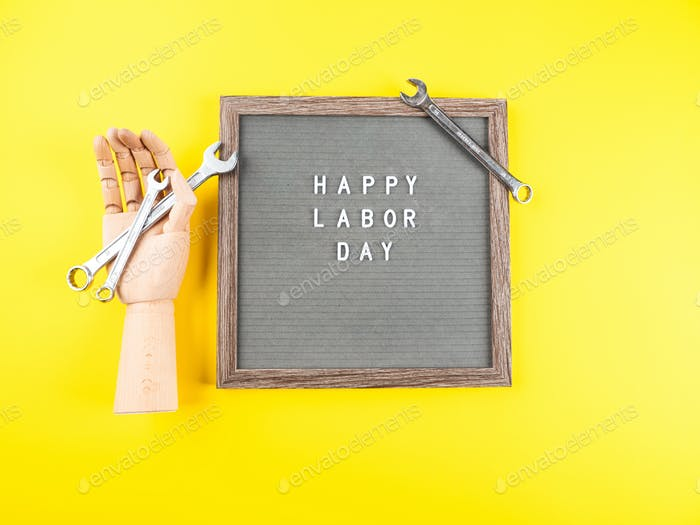 Happy Labor Day greetings on letter board with spanners