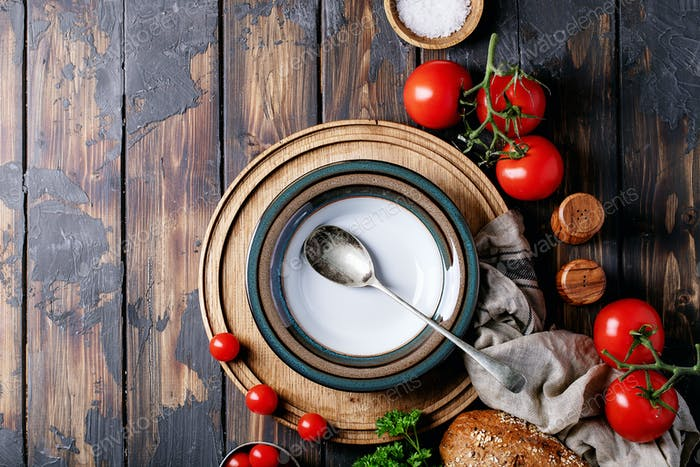 Empty ceramic plate with fresh tomatoes