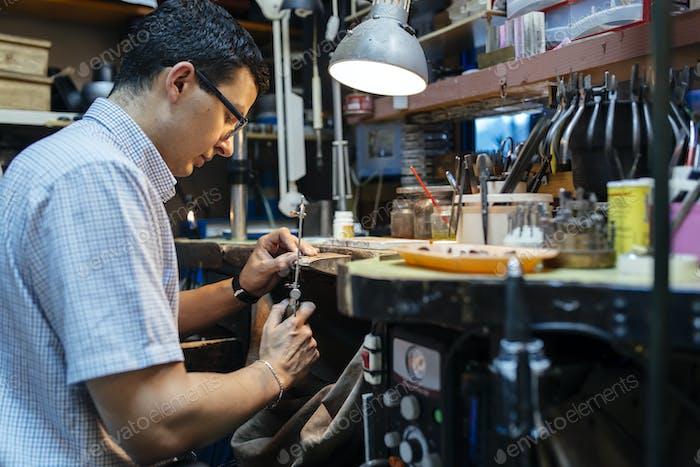Jeweler desining jewelry