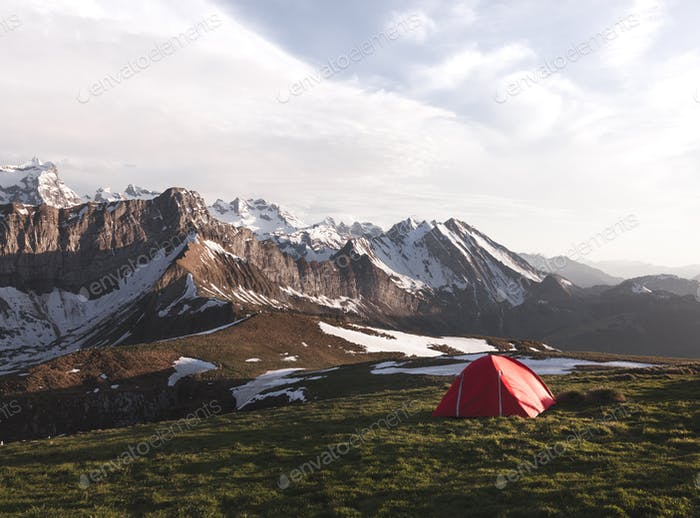 Tent in front of a Mountain Ridge in Switzerland