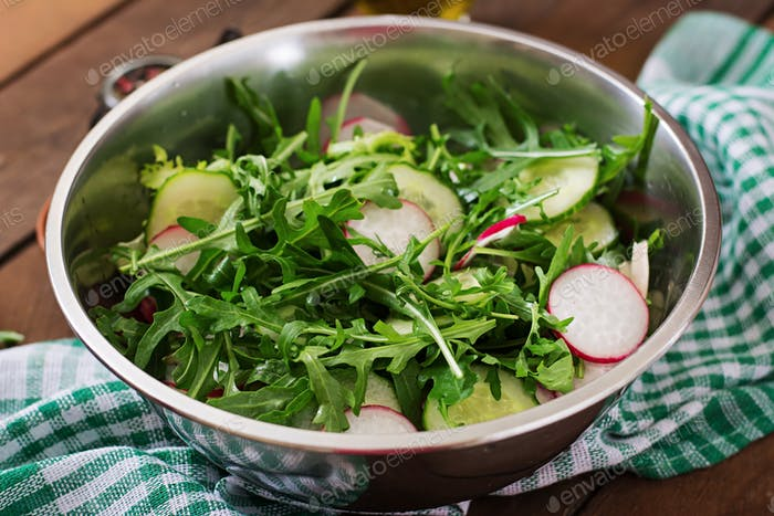 Ingredients for Salad arugula, radish, cucumber and spices