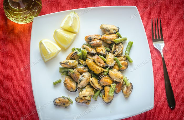 Fried mussels on the square plate