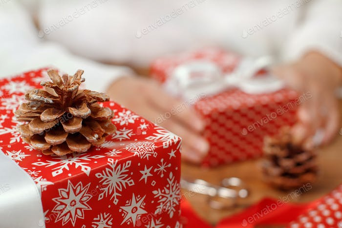 Hands with wrapped present