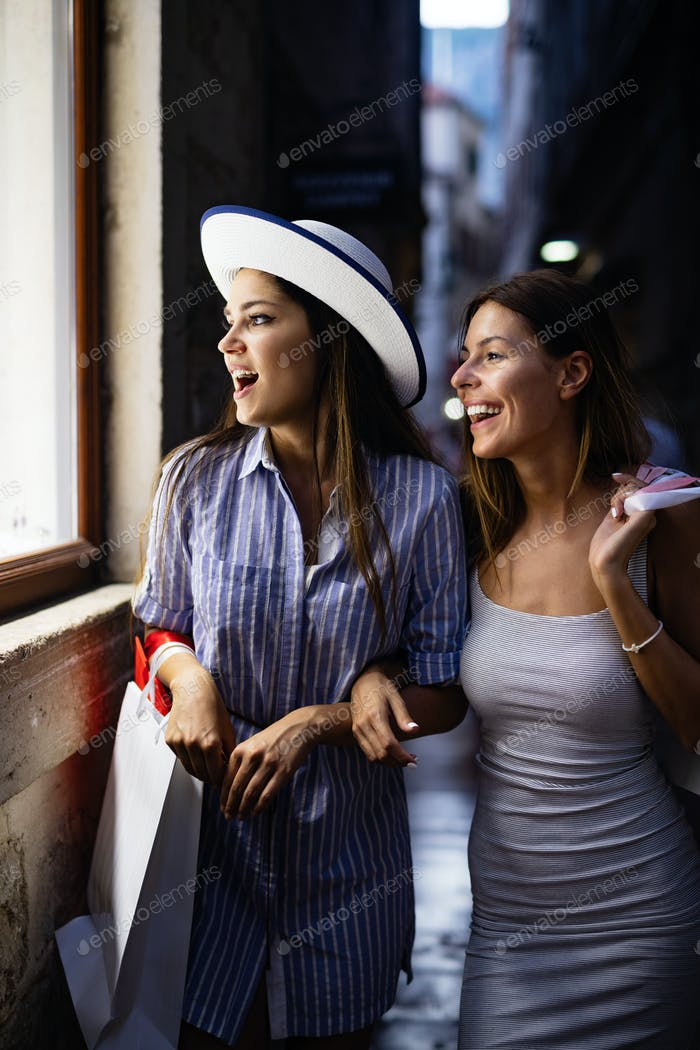 Happy young women enjoying shopping on vacation
