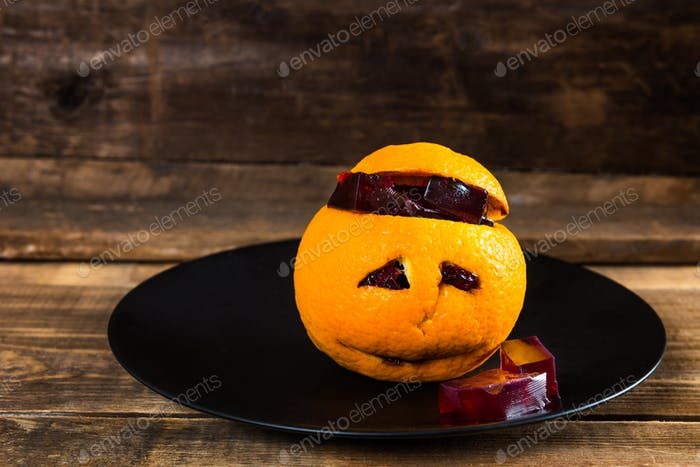 Halloween Table set with Bloody Jelly inside the orange