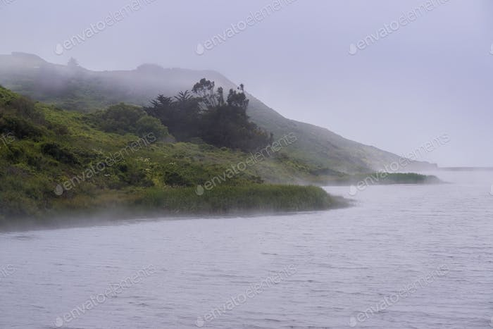 The shoreline of Rodeo Lagoon covered in fog