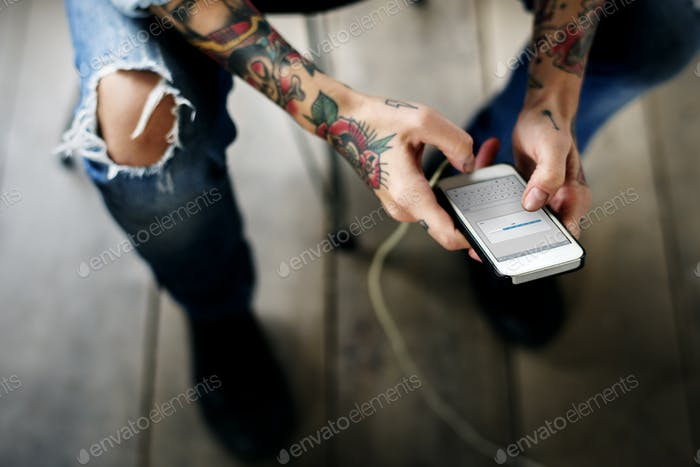 Hand Holding Mobile Phone Showing Downloading Data Screen