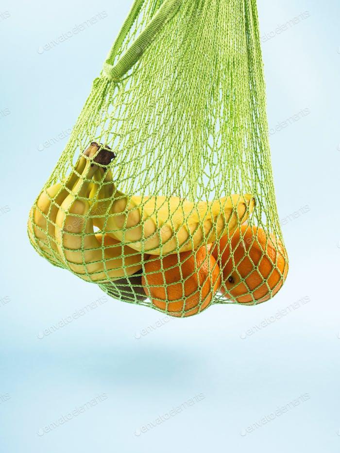 Mesh shopping bag with bananas. Zero waste