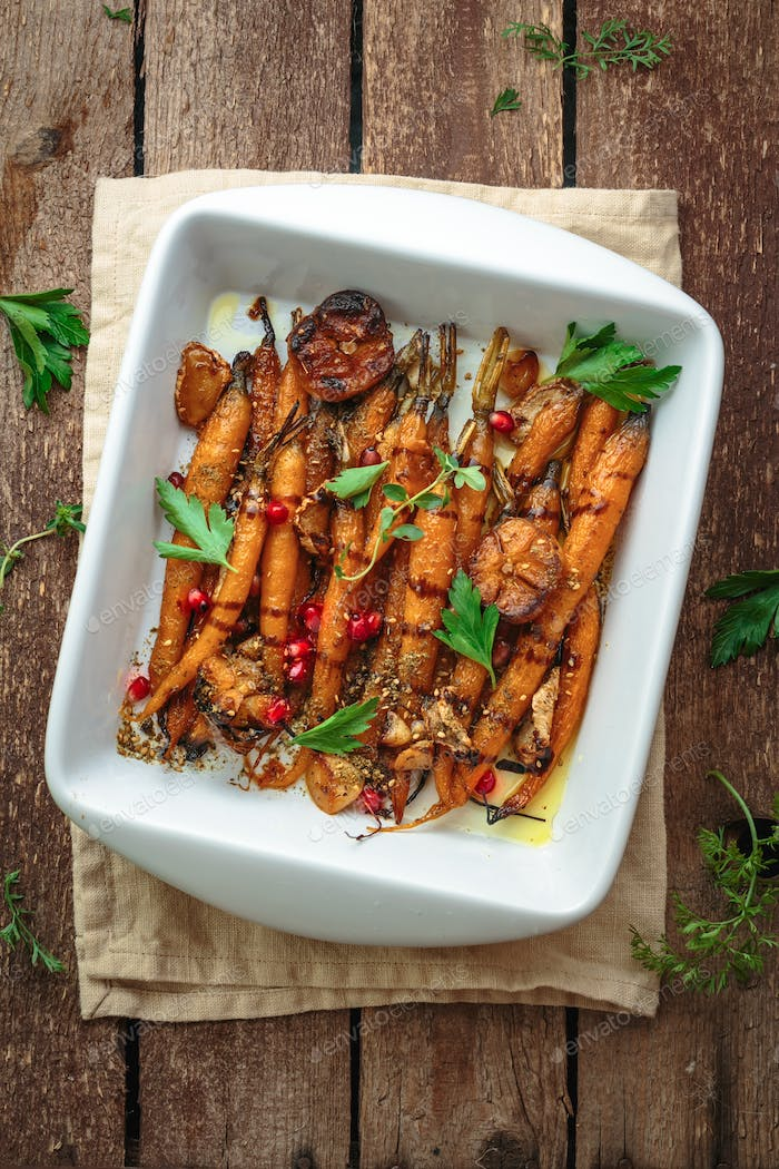 Close view Baked carrots with garlic, ginger and zaahtar