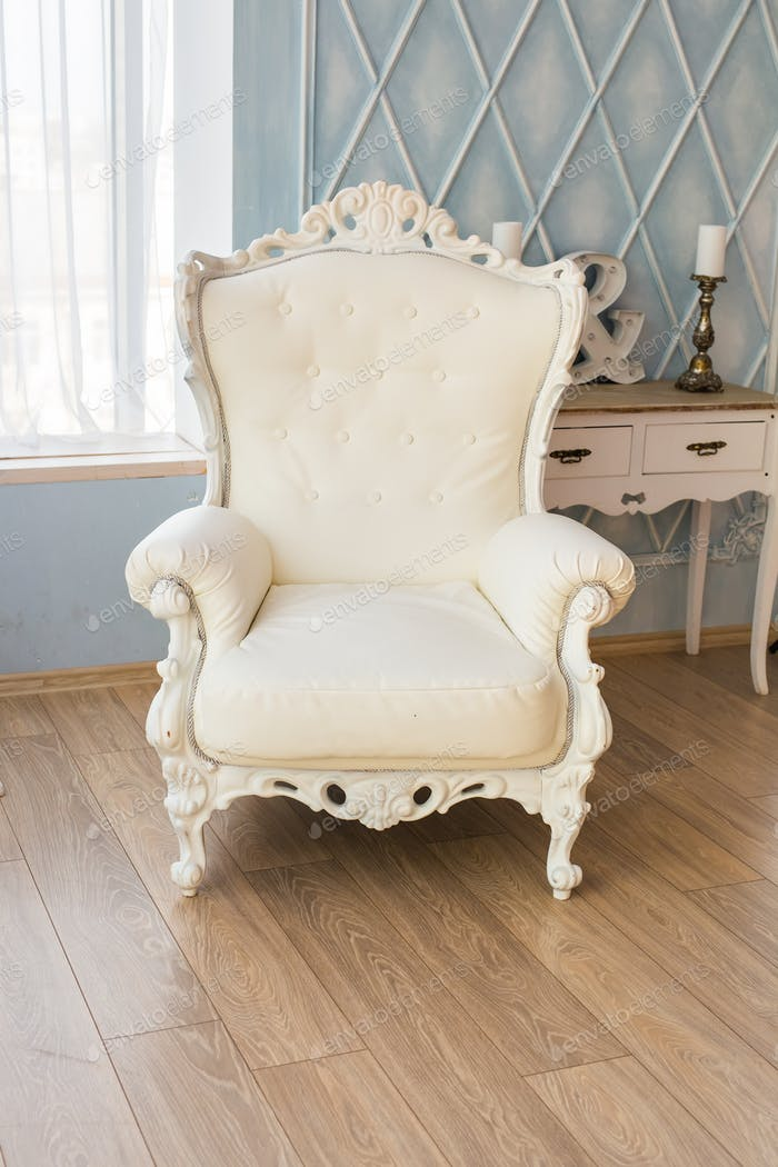 luxury armchair in a plain white interior