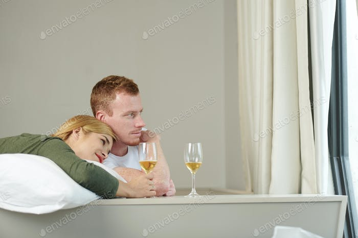 Young couple drinking wine