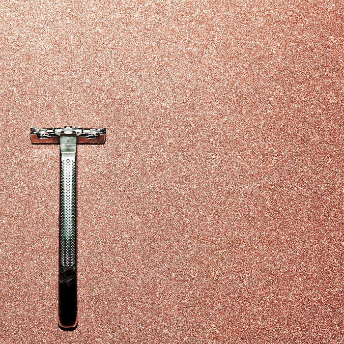 Razor on a gold background. Minimal