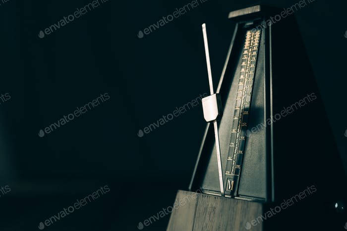 Thumbnail for Vintage metronome, on a dark background.