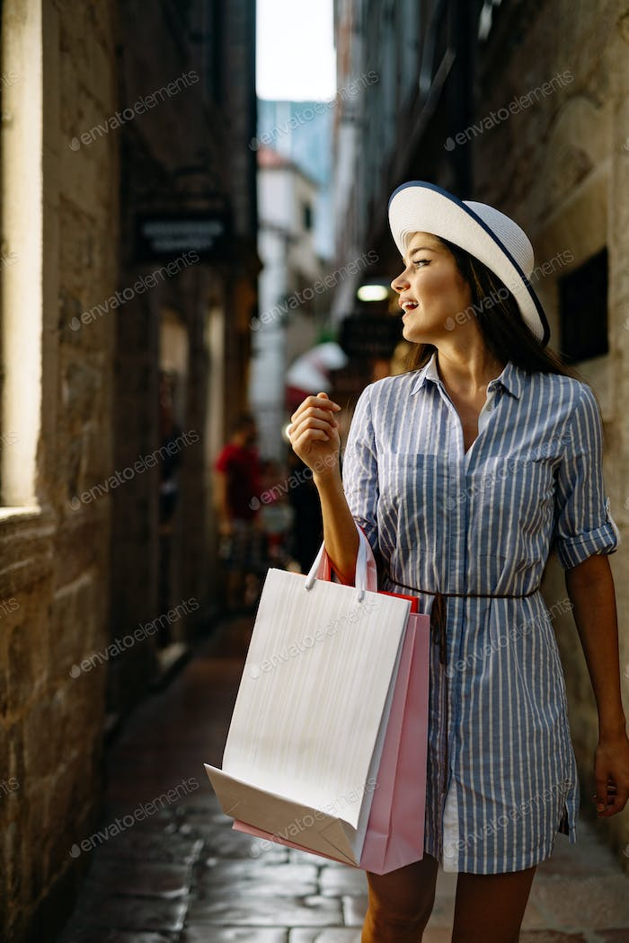 Portrait of happy smiling girl with shopping bags