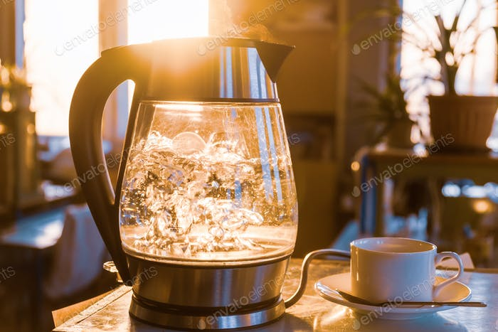 Transparent kettle with water boils