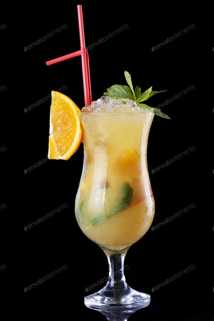 cocktail in glass isolated on black background