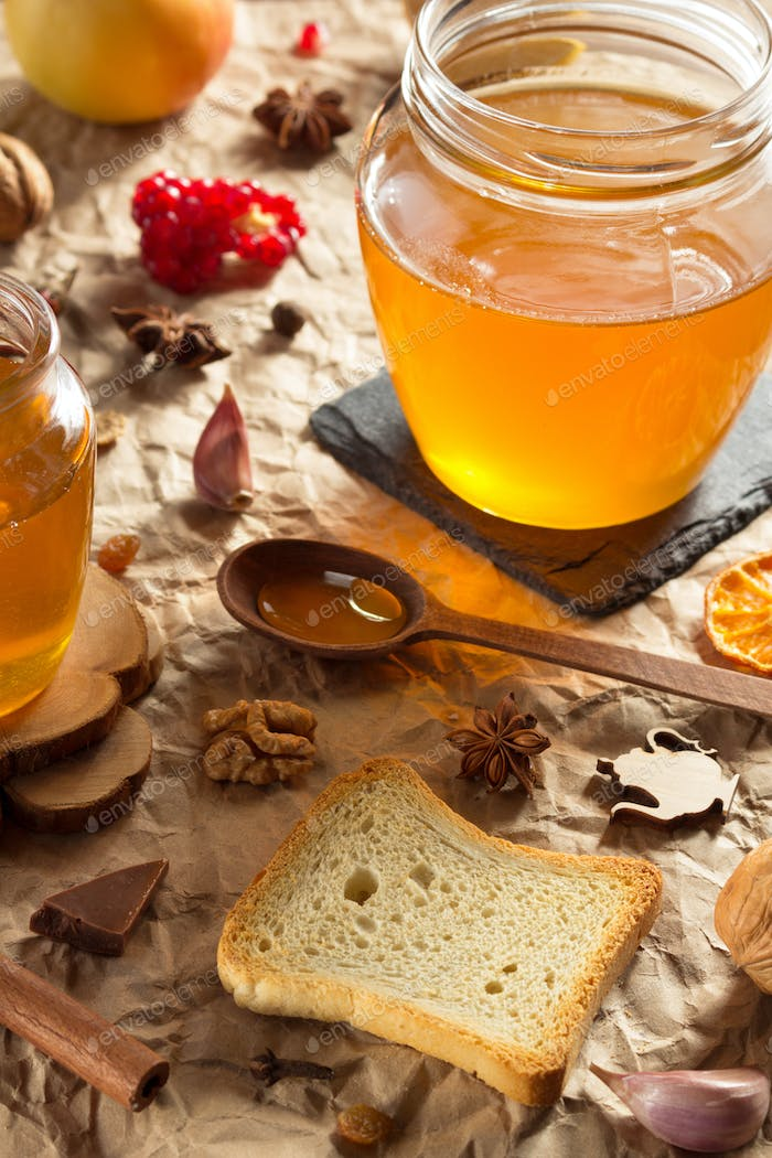 glass jar of honey on paper