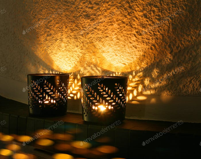 Small candle cups reflecting light