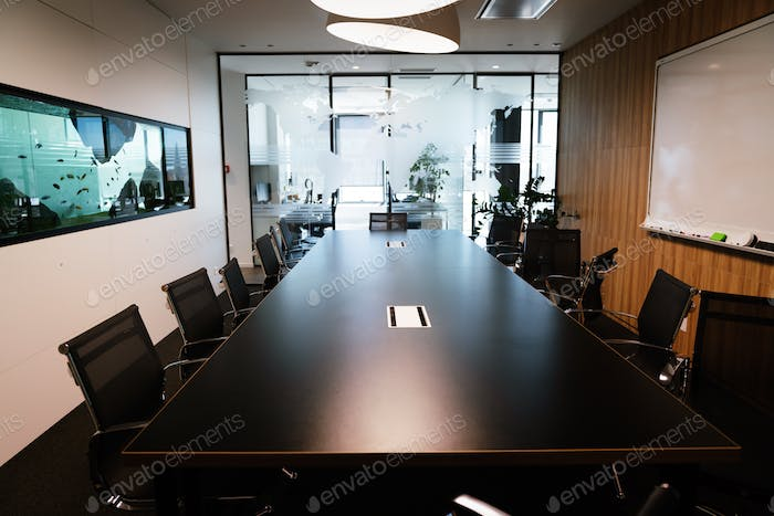 Empty conference room with board room table