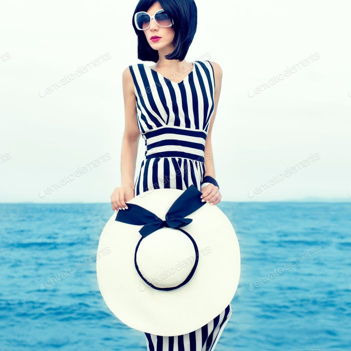 fashion portrait of a beautiful girl on vacation